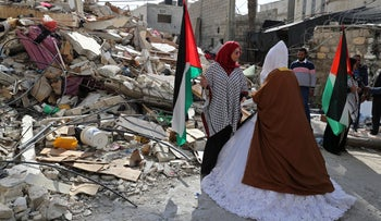 Palestinian bride Shayma Al-Huwaity is seen near her family house that was damaged recently in an Israeli air strike on a nearby Hamas site, on her wedding day in Gaza City, April 5, 2019.