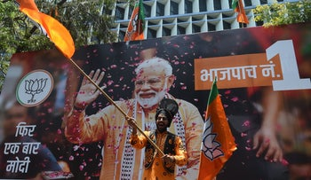 An Indian supporter of Indian Prime Minister Narendra Modi's Bharatiya Janata Party (BJP) celebrates the election results outside the BJP headquarters in Mumbai, May 23, 2019.