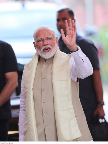 Indian Prime Minister Narendra Modi waves to the media as he arrives at the Bharatiya Janata Party (BJP) headquarters, New Delhi, India, May 21, 2019.