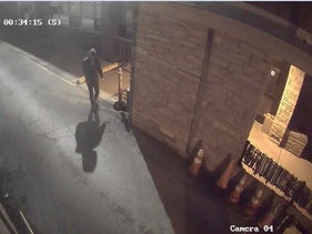 Surveillance video screenshot from about 12:30 a.m. Sunday near Anshe Sholom B'nai Israel Congregation in the city's Lakeview neighborhood showing the suspect who threw Molotov cocktails at the synagogue, May 19, 2019.