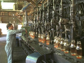 "Manufacturing bottles at the ""Phoenicia"" glass factory in Yeroham."