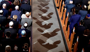 FILE PHOTO: Men wearing Jewish kippa skullcaps attend a ceremony at the Synagogue Rykestrasse in Berlin, to commemorate the 80th anniversary of the Kristallnacht Nazi pogrom, November 9, 2018.