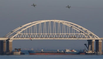 FILE Photo: Russian jet fighters fly over a bridge connecting the Russian mainland with the Crimean Peninsula after three Ukrainian navy vessels were stopped by Russia from entering the Sea of Azov, Crimea, November 25, 2018.
