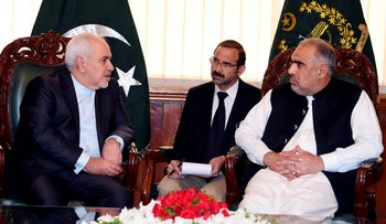 Iranian Foreign Minister Mohammad Javad Zarif meets Speaker National Assembly Asad Qaiser in Islamabad, Pakistan, May 24, 2019.