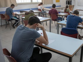 File photo: Students take an exam at a high school in Israel.
