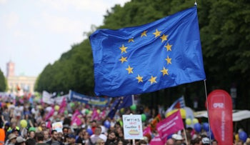 """A European flag flies during the pro-Europe demonstration """"One Europe for all -  your voice against nationalism"""" a week before European elections in Berlin, on May 19, 2019."""