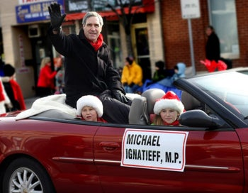 Michel Ignatieff at the Lakeshore Santa Claus Parade with his two children, during his time as a lawmaker for Canada's Liberal Party, December 2009.