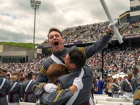 West Point graduates celebrate at the conclusion of the U.S. Military Academy Class of 2019 graduation ceremony at Michie Stadium on May 25, 2019 in West Point, New York