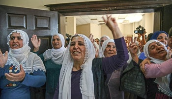 Supporters and relatives of Kurdish prisoners in hunger strike react after a press conference to announce the end of their hunger strike, Diyarbakir, southeast Turkey, May 26, 2019.