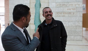 Lawyer Jamal Hamoud, left, with Amin Abu Sakik, convicted of polygamy, outside of the Be'er Sheva Magistrate's Court, February 28, 2019.