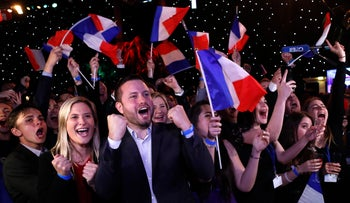 Far-right supporters react at their campaign headquarters, Paris, France, May 26, 2019.