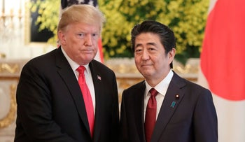 U.S. President Donald Trump shakes hands with Japanese Prime Minister Shinzo Abe, Tokyo, May 27, 2019.