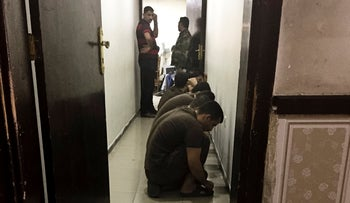 Suspected Islamic State militants wait for sentencing at the counter-terrorism court, Baghdad, May 23, 2018.