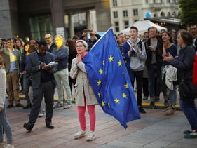 A woman holding an EU flag during a festival outside the European Parliament in Brussels, May 26, 2019.