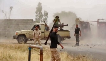 File photo: Fighters loyal to Hiftar reportedly advancing on a road south of the capital Tripoli, May 26, 2019.