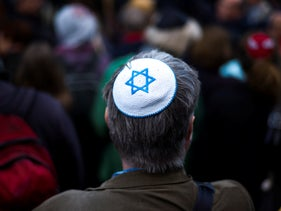 A man wears a kippah in solidarity at a demonstration against an anti-Semitic attack in Berlin.