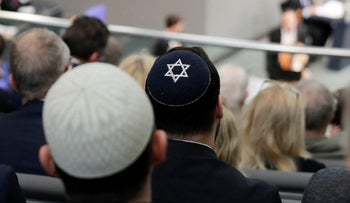 File photo: Two men wearing skullcaps during a remembrance event of the parliament Bundestag to commemorate the victims of the Holocaust at the Reichstag building in Berlin, Germany, January 31, 2019.