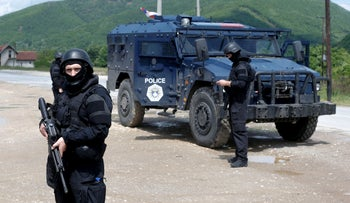Kosovo police special unit members during an ongoing police operation to secure the area near the village of Cabra, northwestern Kosovo, May 28, 2019.