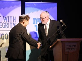Newly ordained Rabbi Daniel Atwood is congratulated by Rabbi Daniel Landes at the Jerusalem Theater, May 26, 2019.