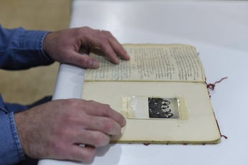 Nir Itzik on the final page of Judit Ornstein's diary at the Moreshet Archive in central Israel. He found the diary and had it translated into Hebrew. The diary ends on September 13, 1944.