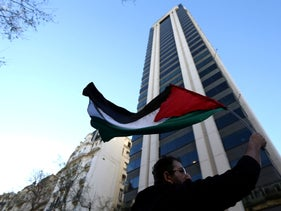 FILE Photo: A man waves a Palestinian flag in front the Israeli Embassy is located, during a protest against the visit of Israel's Prime Minister Benjamin Netanyahu in Buenos Aires, Argentina, September 12, 2017.