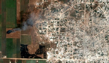 A satellite overview image that shows smoke from fires in Hbit, Idlib Province, Syria May 26, 2019. Picture taken May 26, 2019.