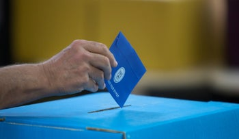 An Israeli man casts his vote during Israel's general elections in Tel Aviv, Israel, Tuesday, April 9, 2019.