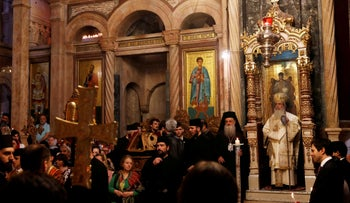 Greek Orthodox Patriarch of Jerusalem Metropolitan Theophilos leads the Easter Sunday Mass at the Church of the Holy Sepulchre in Jerusalem's Old City, April 28, 2019.