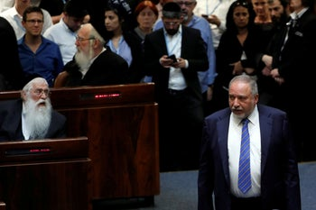 Israel's former Defense Minister Avigdor Lieberman stands at the plenum at the Knesset, Israel's parliament, in Jerusalem. May 30, 2019