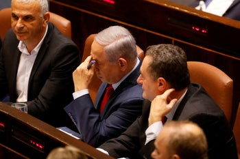 Israeli Prime Minister Benjamin Netanyahu before voting in the Knesset, Israel's parliament in Jerusalem, Wednesday, May 29, 2019.