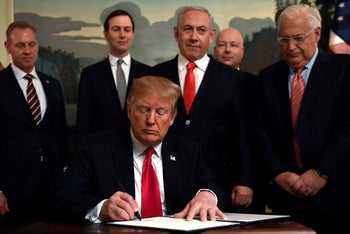 President Donald Trump, front, signs a proclamation in the Diplomatic Reception Room at the White House in Washington, Monday, March 25, 2019. Trump signed an official proclamation formally recognizing Israel's sovereignty over the Golan Heights. Others attending are, from left, Acting Defense Secretary Patrick Shanahan, White House adviser Jared Kushner, Israeli Prime Minister Benjamin Netanyahu, U.S. special envoy Jason Greenblatt, and U.S. Ambassador to Israel David Friedman. (AP Photo/Susan Walsh)