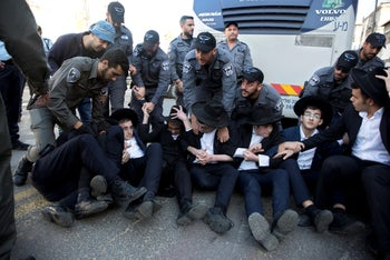 Ultra-Orthodox men protest the IDF conscription bill, in Bnei Brak, 2018.