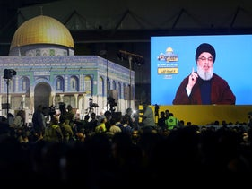 Lebanon's Hezbollah leader Hassan Nasrallah addresses his supporters via a screen during a rally marking al-Quds Day, (Jerusalem Day) in Beirut, Lebanon May 31, 2019.