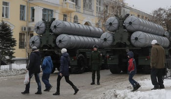 FILE PHOTO: People walk past Russian S-400 missile air defense systems before the military parade to commemorate the anniversary of the battle of Stalingrad in Volgograd, Russia, February 2, 2018.