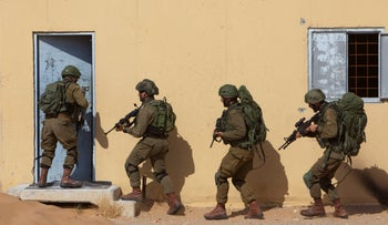 Israeli soldiers train at a compound that simulates a Palestinian village in Tze'elim, May 2019.