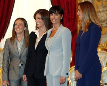 Giorgia Meloni (L) being sworn in as Italy's Youth Policies Minister in Silvio Berlusconi's government in May, 2008, at the Quirinale palace in Rome