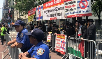 Satmar Hasidic Jews, who are known for their anti-Zionist views, protest on the sidelines of the march in New York, June 2, 2019.