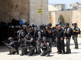 Israeli police officers take positions during clashes with Palestinians by the Dome of the Rock Mosque on the Temple Mount in Jerusalem's old city, June 2, 2019.
