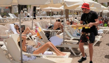 Vacationers relax in Eilat, June 3, 2019.
