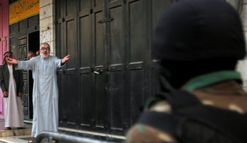 A supporter of Hizb-ut Tahrir party gestures as Palestinian security forces detain the party members who try to perform Eid al-Fitr prayer, Hebron, June 4, 2019.