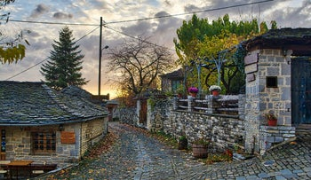 Sunset on a traditional alley in Megalo Papingo village in Ioannina, Greece.
