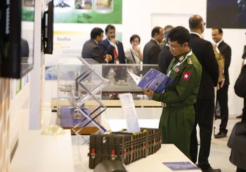 A representative of Myanmar's military at the Israel Defense and Homeland Security Expo in Tel Aviv, June 4, 2019.