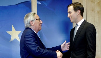 Jared Kushner, right, shakes hands with European Commission President Jean-Claude Juncker prior to a meeting at EU headquarters in Brussels, Tuesday, June 4, 2019.