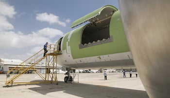A passenger plane that was reconfigured to be used by Amazon as a cargo plane.