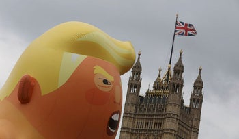 A giant inflatable blimp depicting Donald Trump as a pouting baby floats during an anti-Trump protest in London, Britain, June 4, 2019
