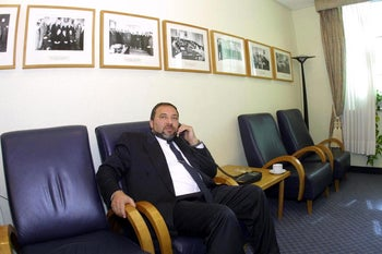 Avigdor Lieberman speaking on the telephone in a government building in 2002.