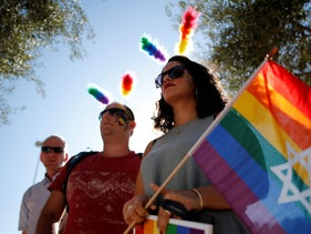 File photo: Participants take part in the annual gay pride parade in Jerusalem, July 21, 2016.