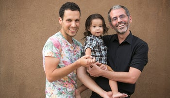 Shahar Globerman (L) and Shay Gortler with their daughter, Tanya, in Tel Aviv in June, 2019.