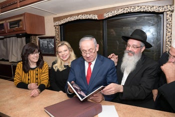 FILE PHOTO: Israeli Prime Minister Benjamin Netanyahu and his wife Sara in a Mitzvah tank, Novemeber 11, 2018.