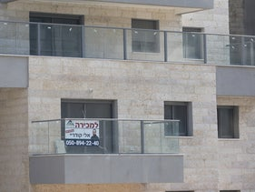For sale signs on apartments in Harish, May 13, 2019.